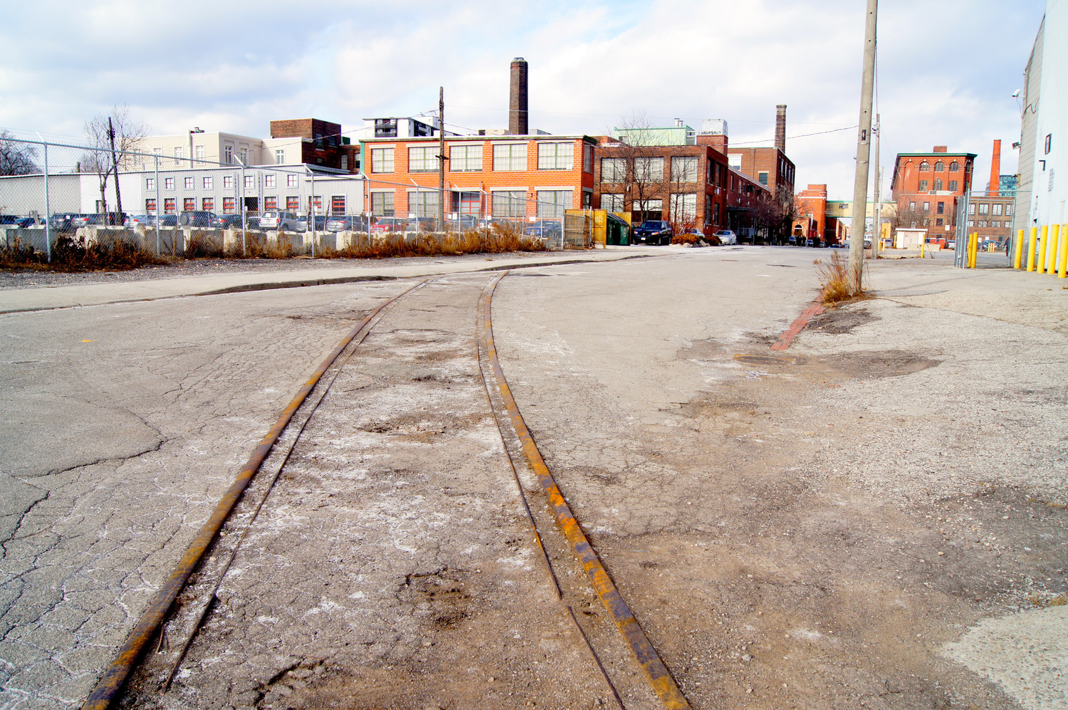 This photo is in the west side of Liberty Village. I was poking around the streets one day and noticed the tracks. I got down almost on my knees to try to capture a track-level view. Some people think that's an old picture, but it taken in 2013.